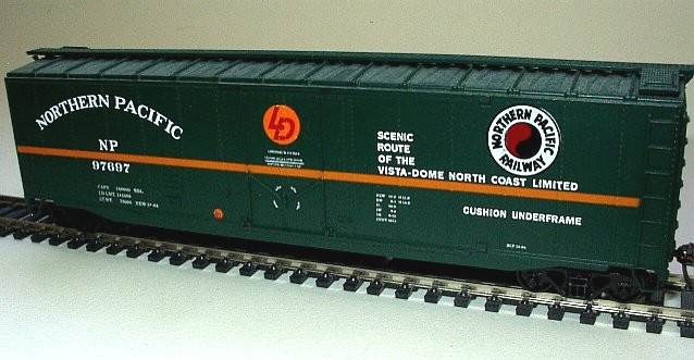 Northern Pacific 50' box cars. Two 50' plug door box cars, dark green with yellow stripe, NP logo.